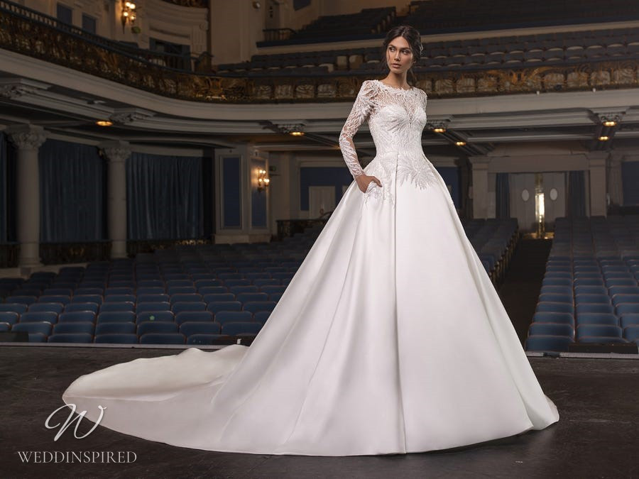 A Pronovias Privée 2021 satin princess ball gown wedding dress with long lace sleeves