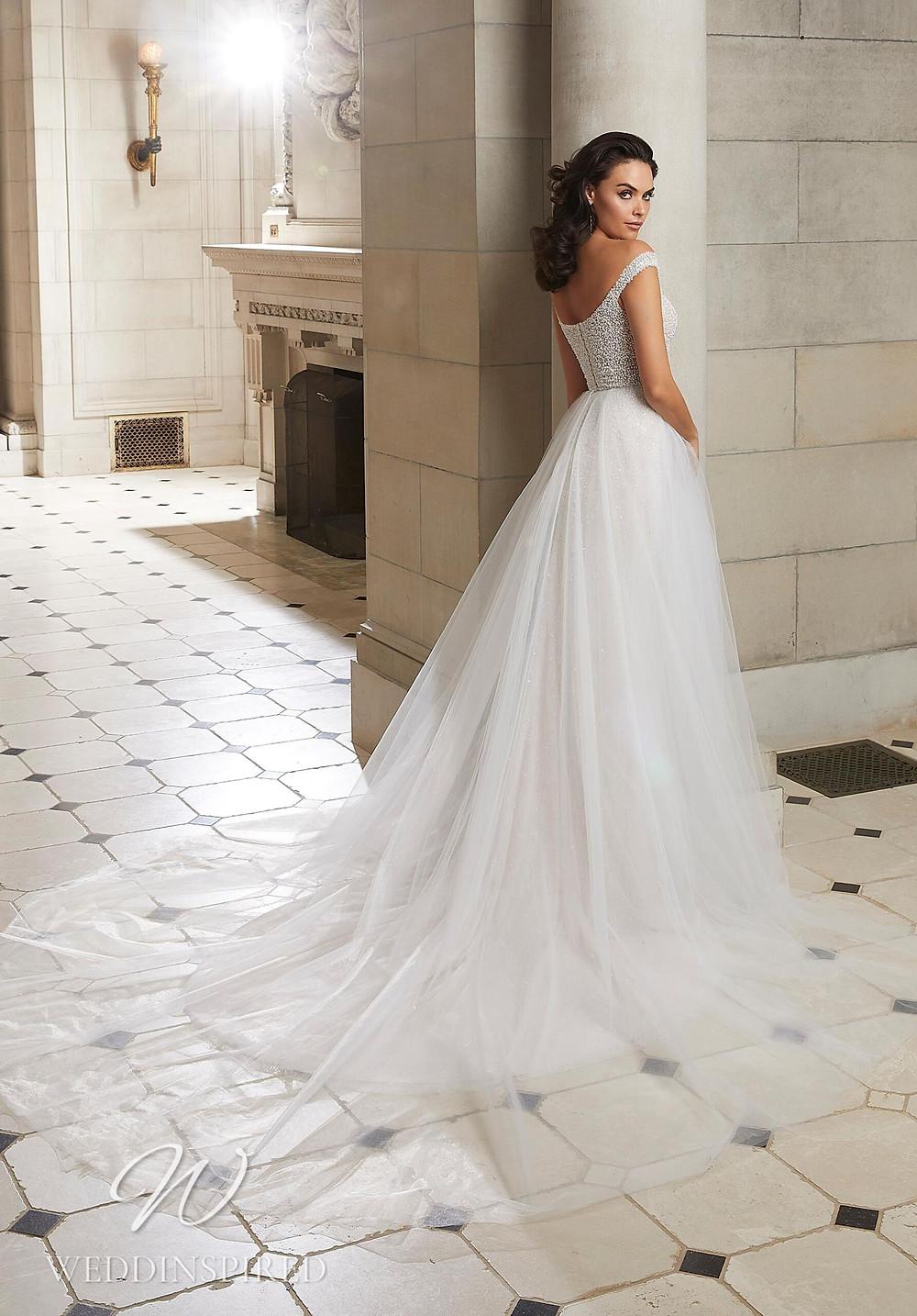 A Madeline Gardner off the shoulder tulle A-line wedding dress