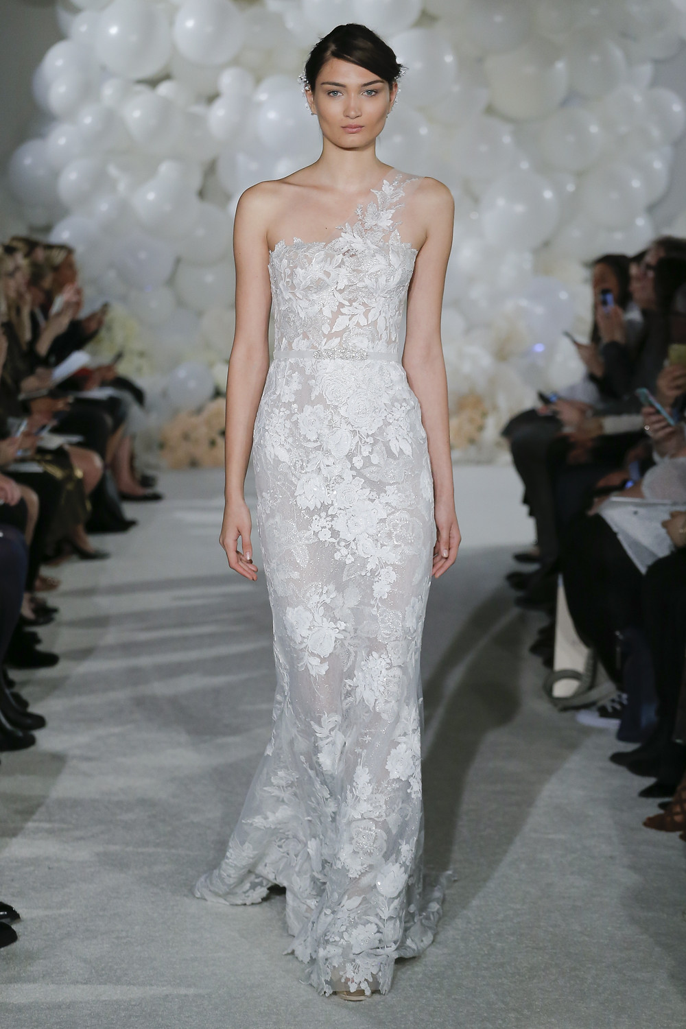 A one shoulder sheath wedding dress with floral print and embellishments