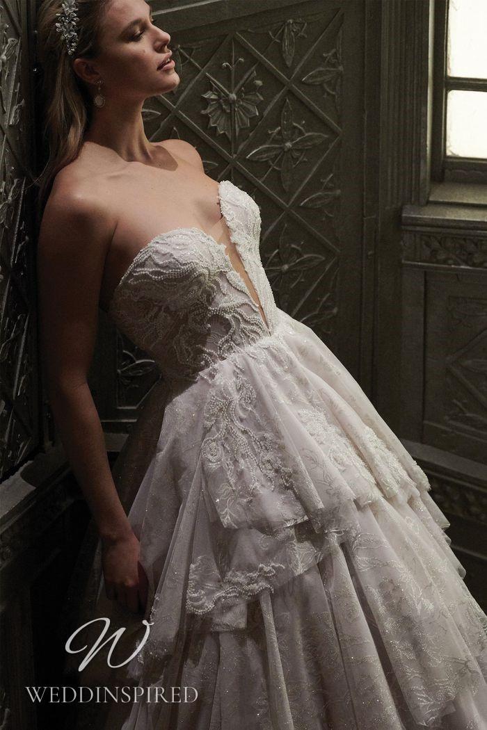 A Justin Alexander 2021 lace A-line wedding dress with a ruffle skirt