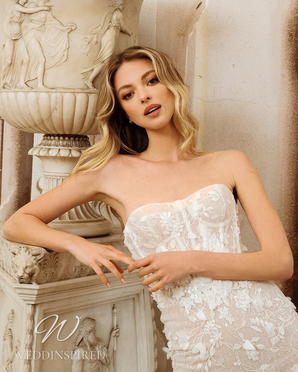 A Berta 2022 strapless lace and tulle mermaid wedding dress