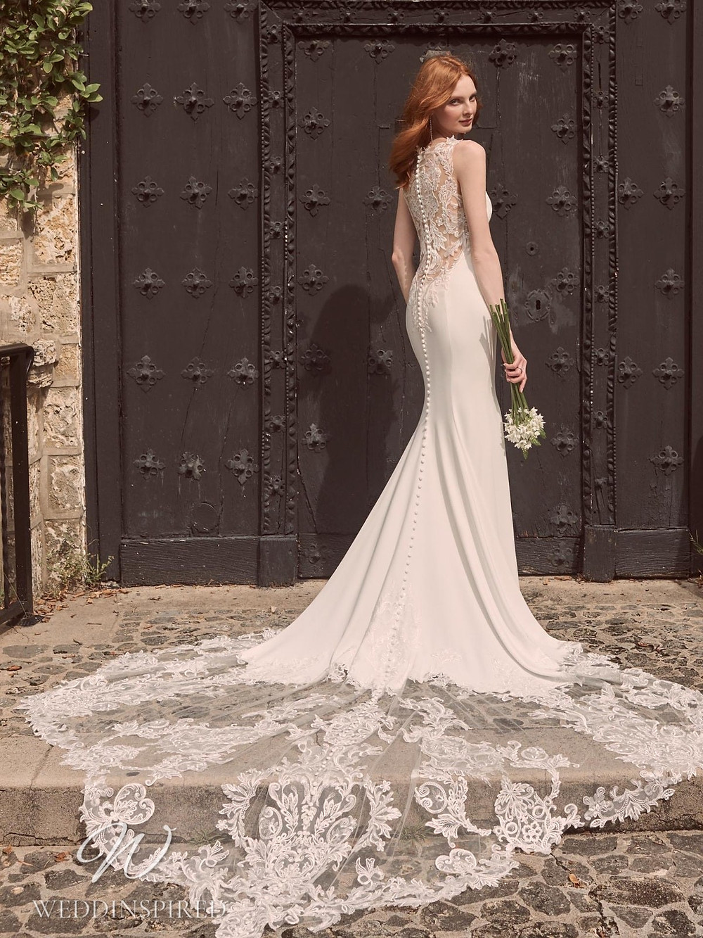 A Maggie Sottero Spring 2021 lace and crepe mermaid wedding dress with buttons and a train