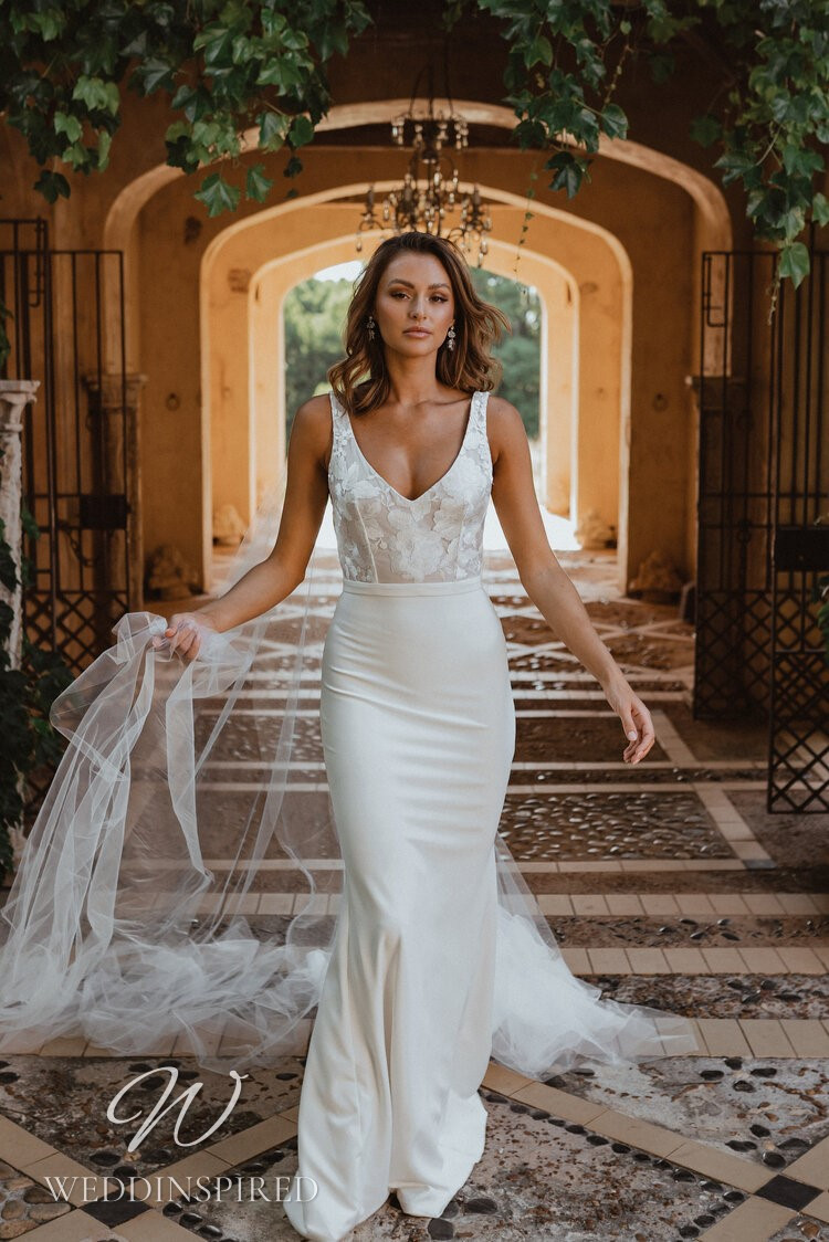 An Anna Campbell 2021 lace and crepe mermaid wedding dress with a v neck