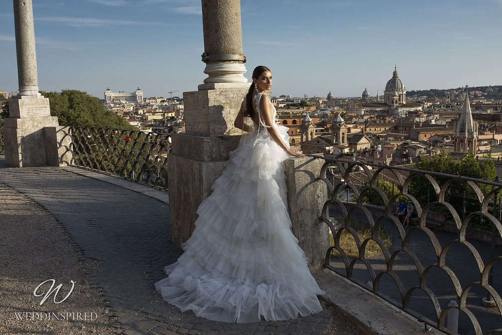A Pinella Passaro tulle ball gown wedding dress with a low back and a ruffle skirt