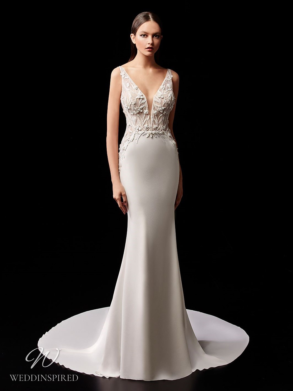 An Enzoani lace and silk mermaid wedding dress with straps and a train