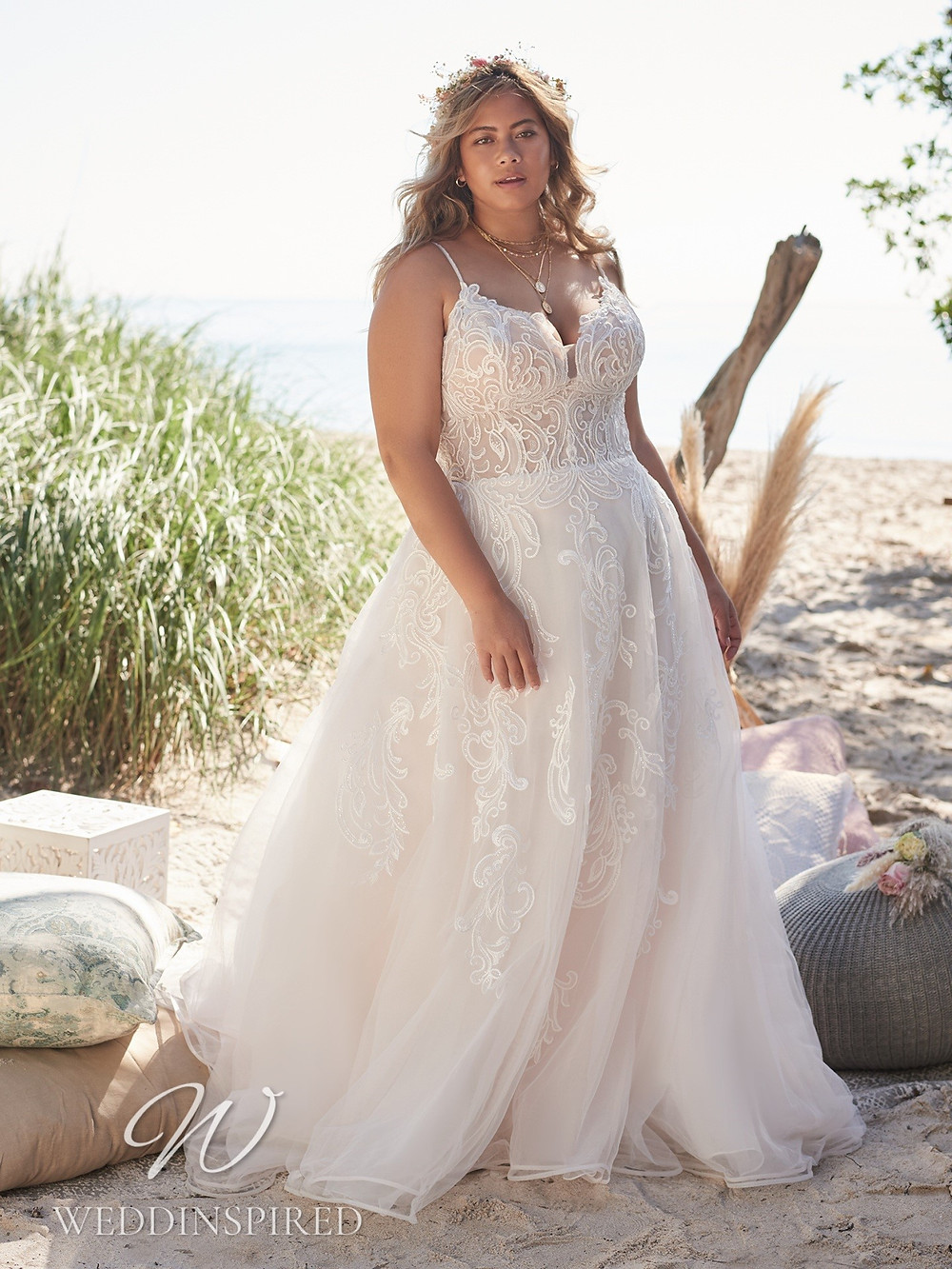 A Rebecca Ingram 2021 plus size blush lace and tulle A-line wedding dress