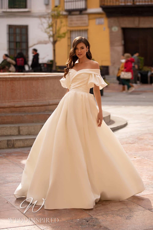 A Nora Naviano 2021 flowy off the shoulder boho A-line wedding dress