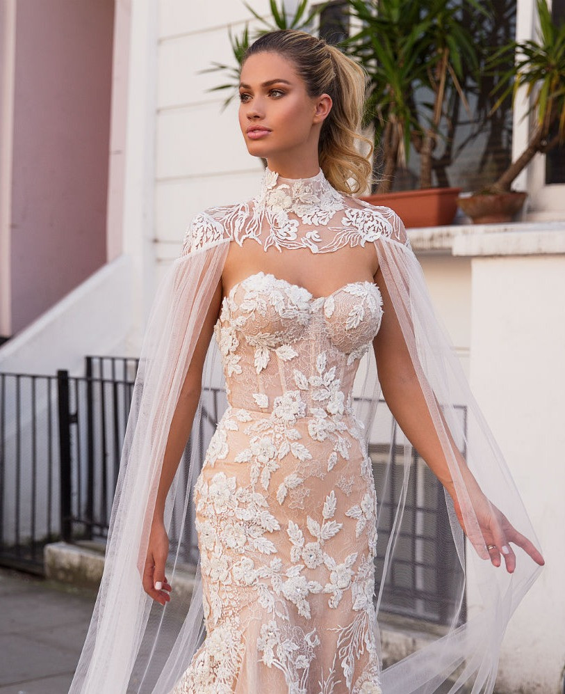 A Milla Nova blush mermaid wedding dress, with lace and a sweetheart neckline
