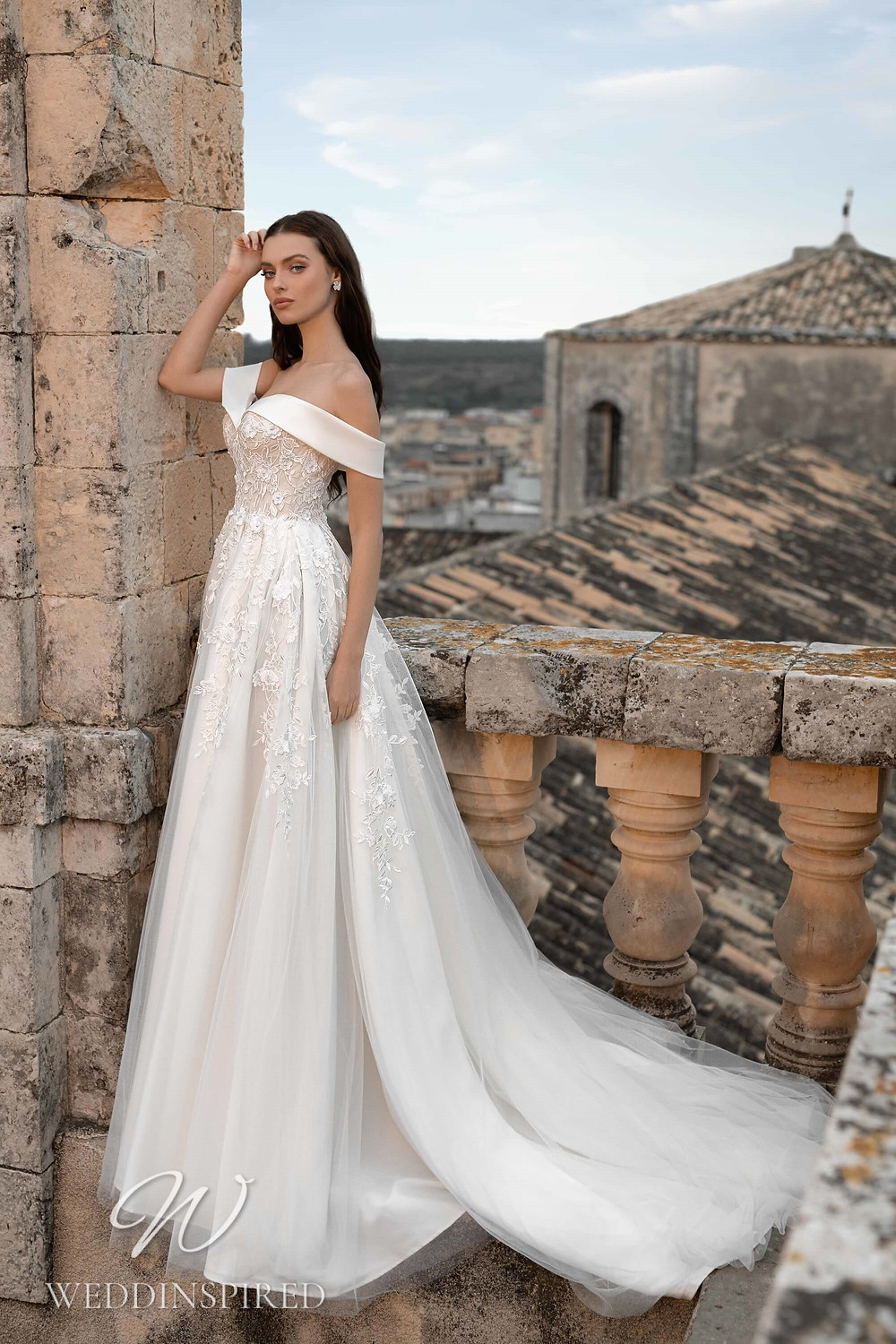 A Lussano 2021 off the shoulder lace and tulle A-line wedding dress