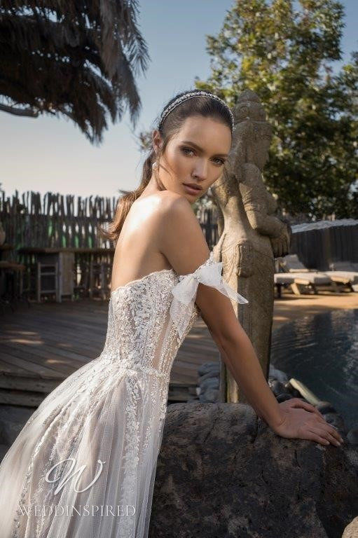 A David Hasbani strapless off the shoulder lace and tulle A-line wedding dress