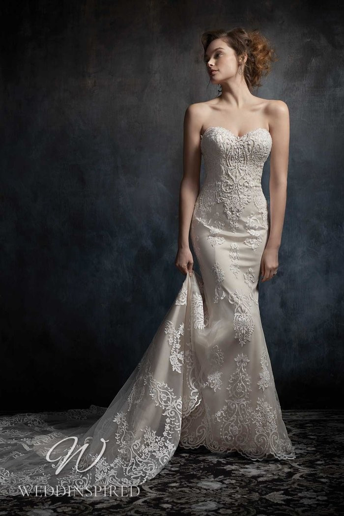 A Kenneth Winston 2021 strapless lace and satin mermaid wedding dress
