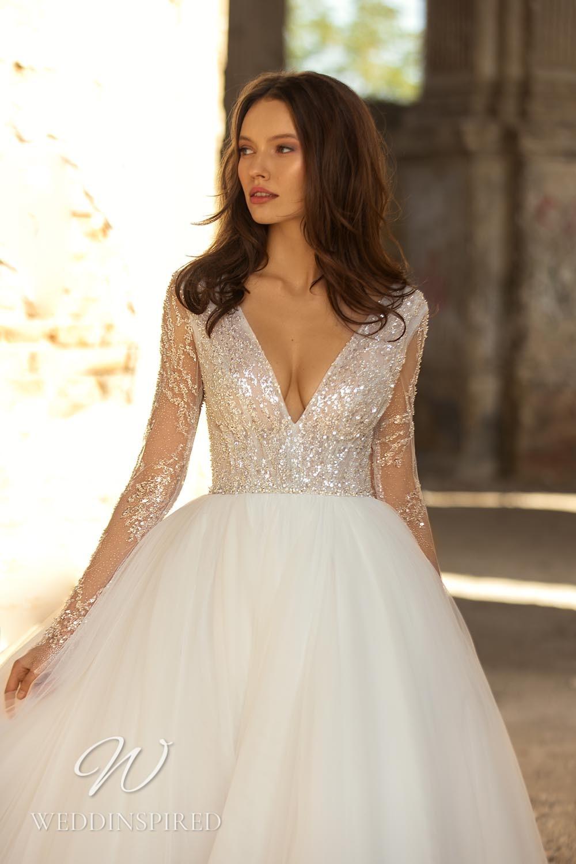 An Eva Lendel 2021 tulle princess wedding dress with a v neck