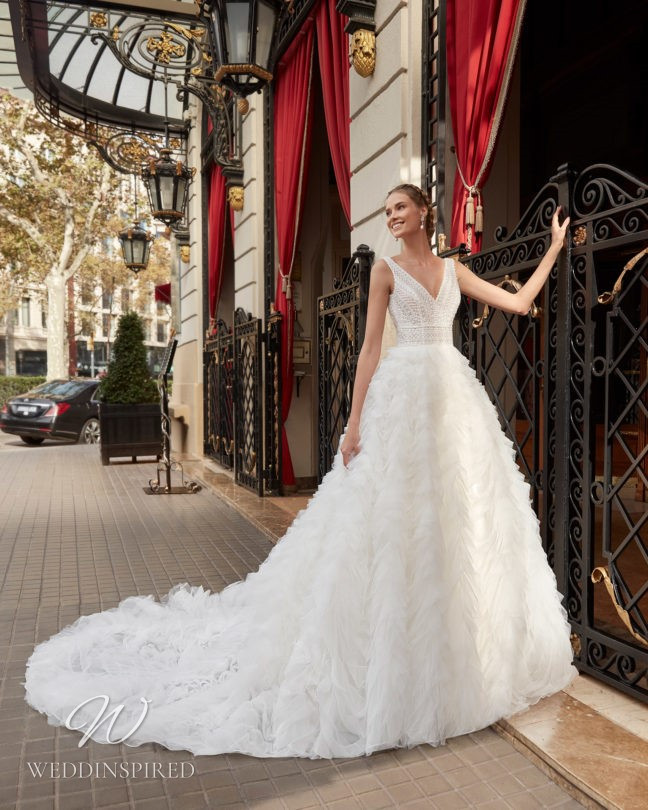 An Aire Barcelona 2021 tulle princess wedding dress with a layered ruffle skirt