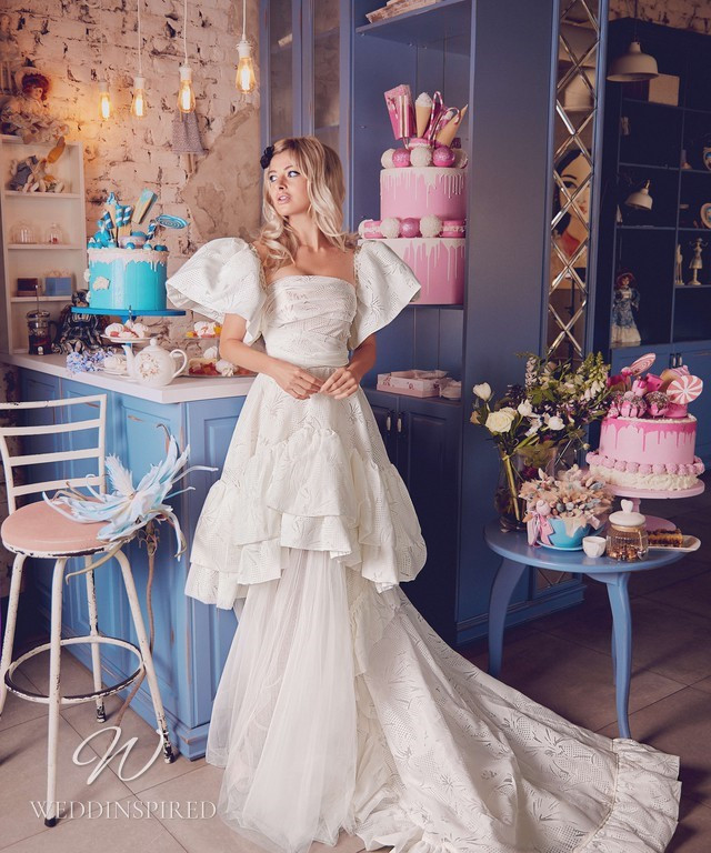 A Blammo-Biamo 2021 A-line wedding dress with a layered ruffle skirt and large short sleeves