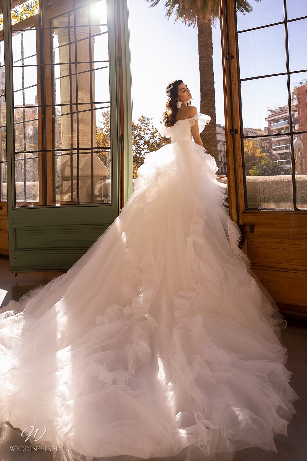 A Maks Mariano off the shoulder tulle princess ball gown wedding dress