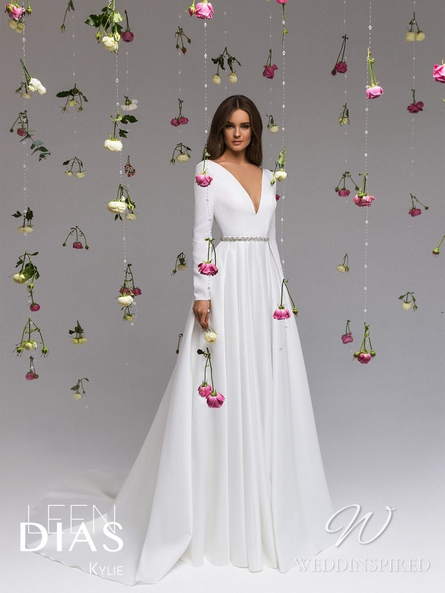 A Leen Dias 2021 simple satin A-line wedding dress with long sleeves and a v neck