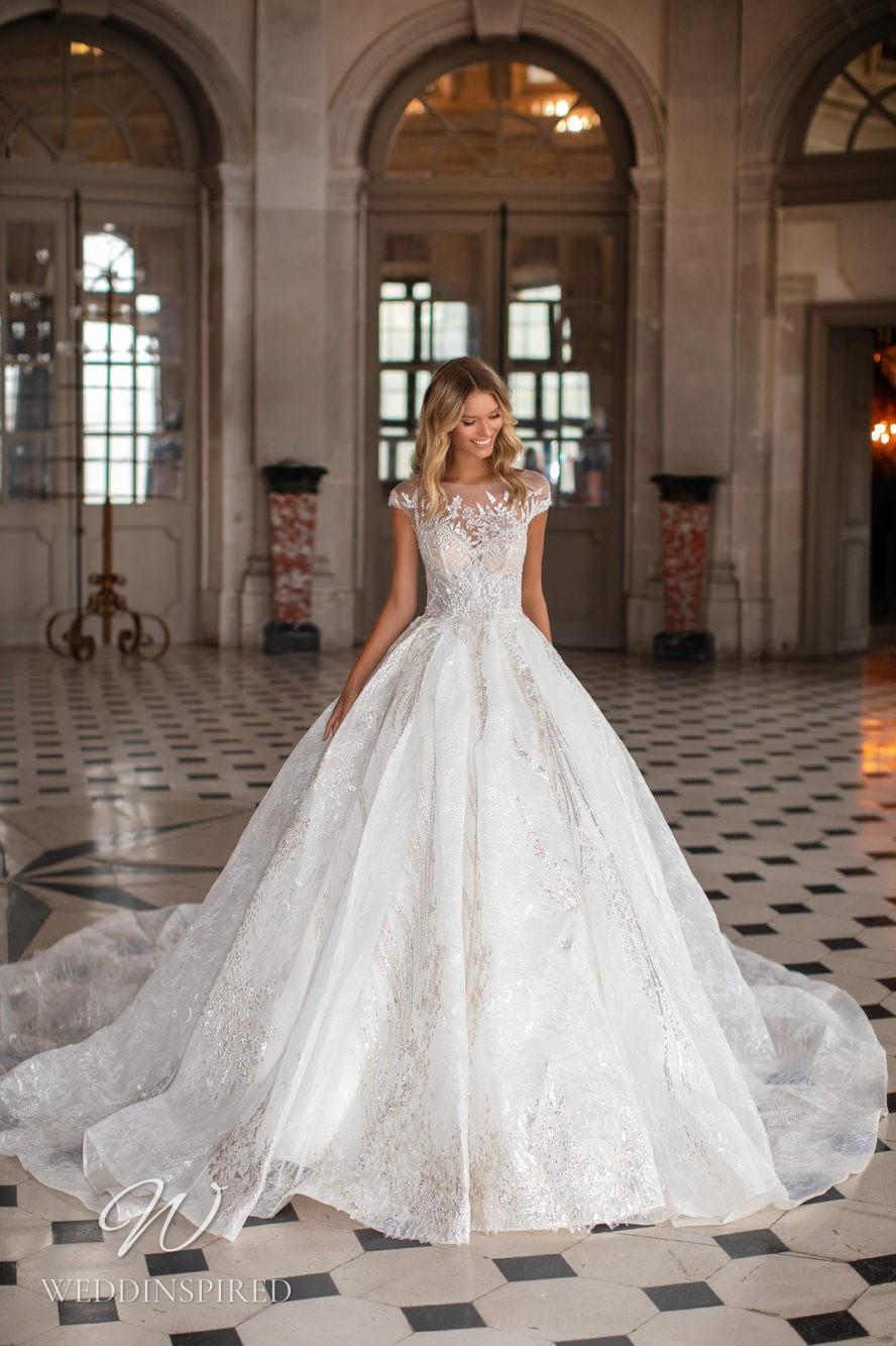 A Milla Nova princess ball gown wedding dress with cap sleeves