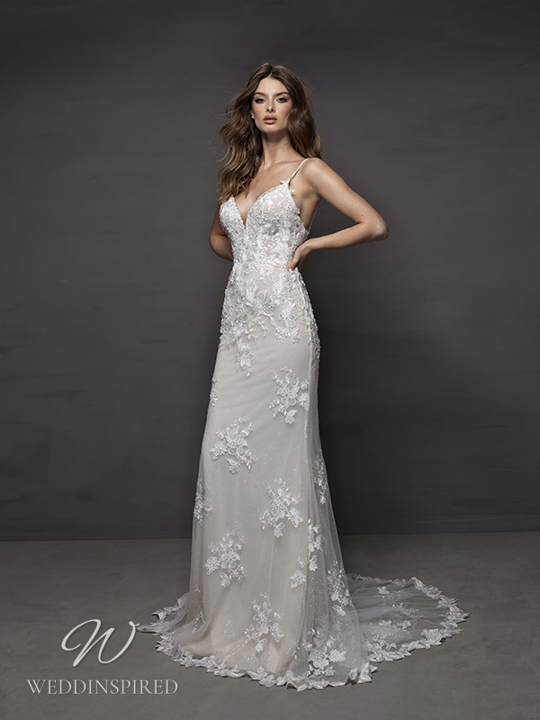 A Riki Dalal 2021 lace mermaid wedding dress with a v neck
