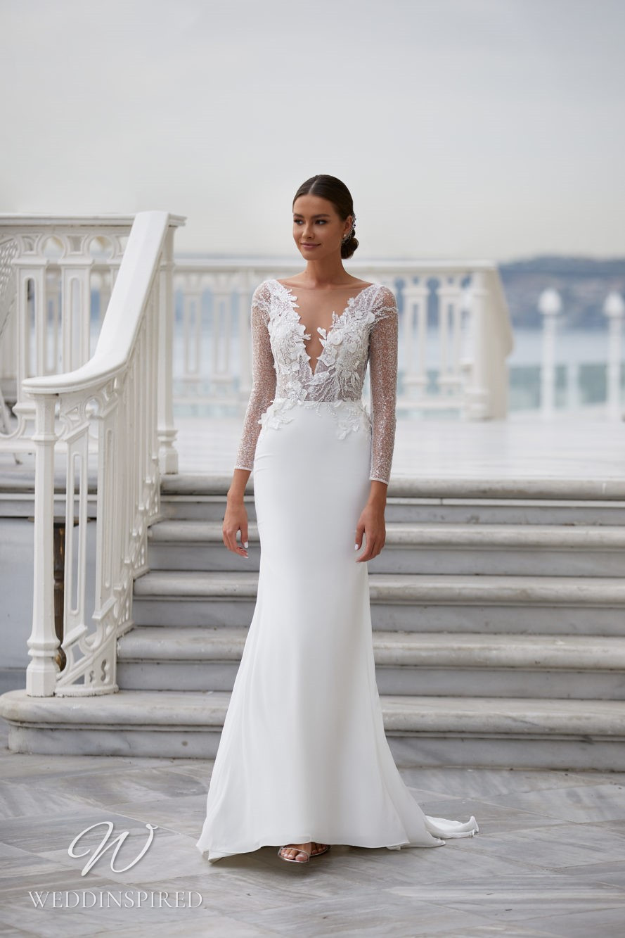 A Milla Nova 2021 sparkly lace and satin mermaid wedding dress with long sleeves and a v neck