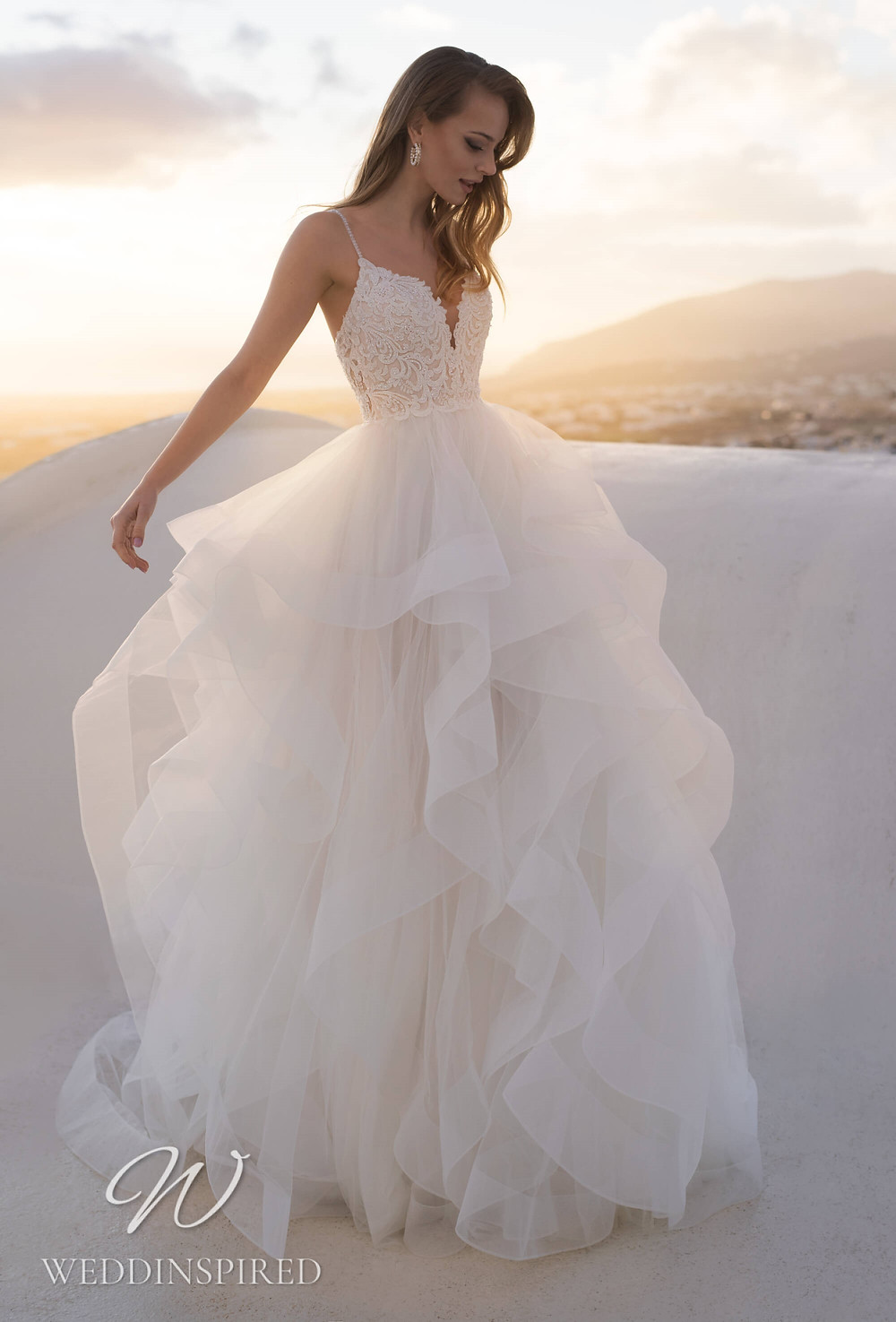A Blunny 2021 tulle and lace A-line wedding dress with a ruffle skirt