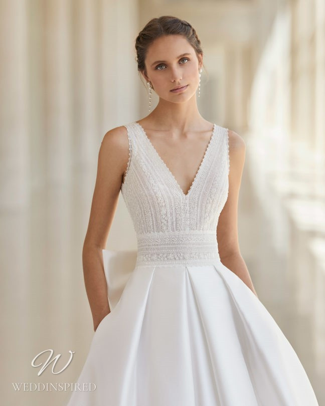 An Aire Barcelona 2021 lace and satin princess ball gown wedding dress with pockets and a v neck