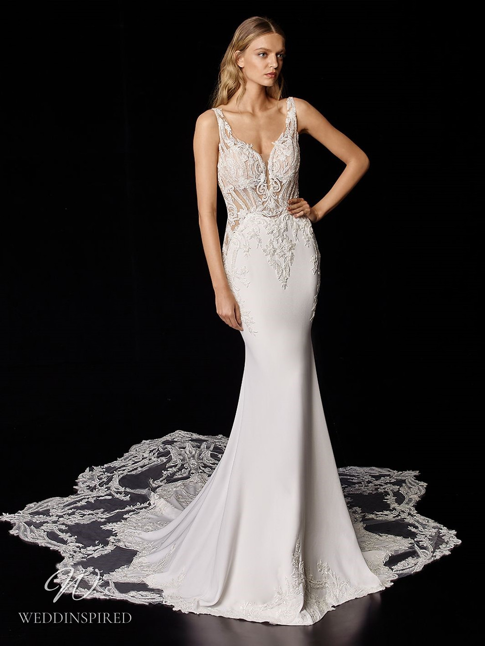 An Enzoani lace and silk mermaid wedding dress with a long lace illusion train