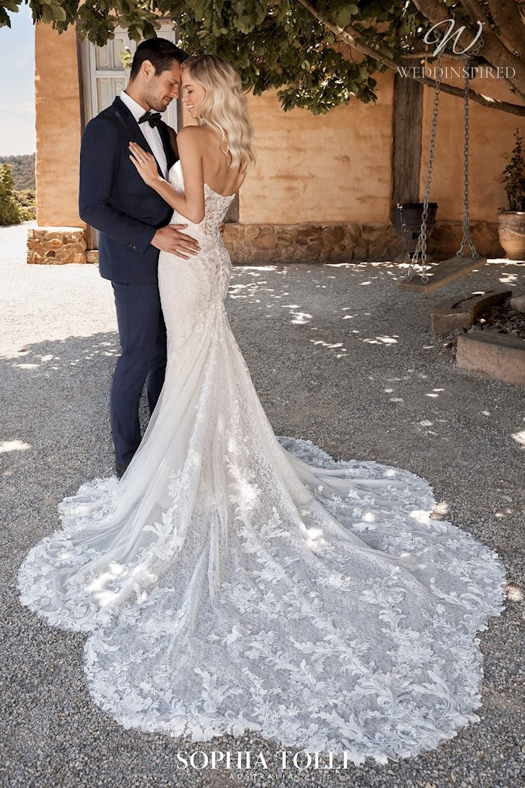A Sophia Tolli strapless lace wedding dress with a train