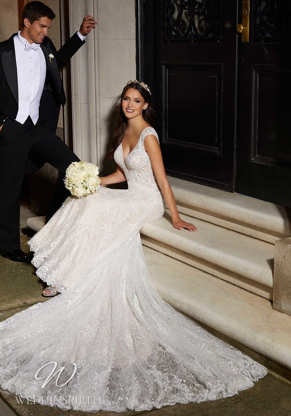 A Madeline Gardner lace A-line wedding dress with cap sleeves
