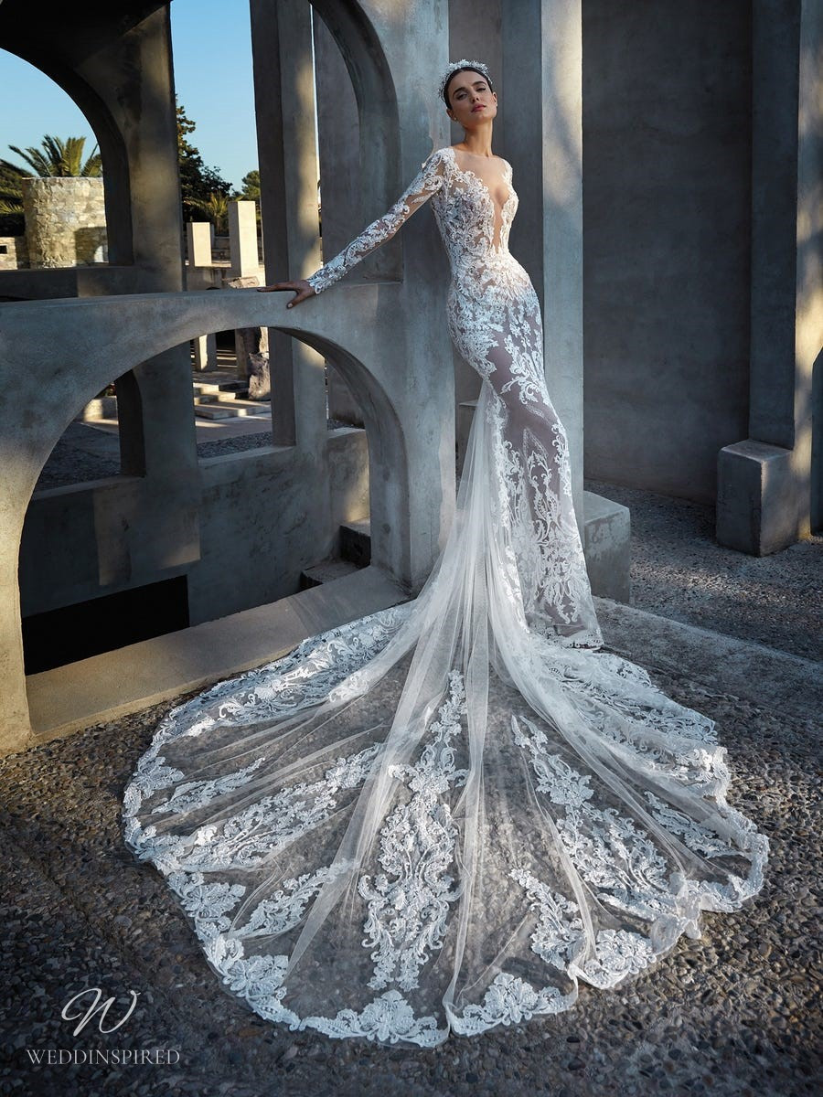 An Atelier Pronovias lace mermaid wedding dress with long sleeves, a low v neckline and a train