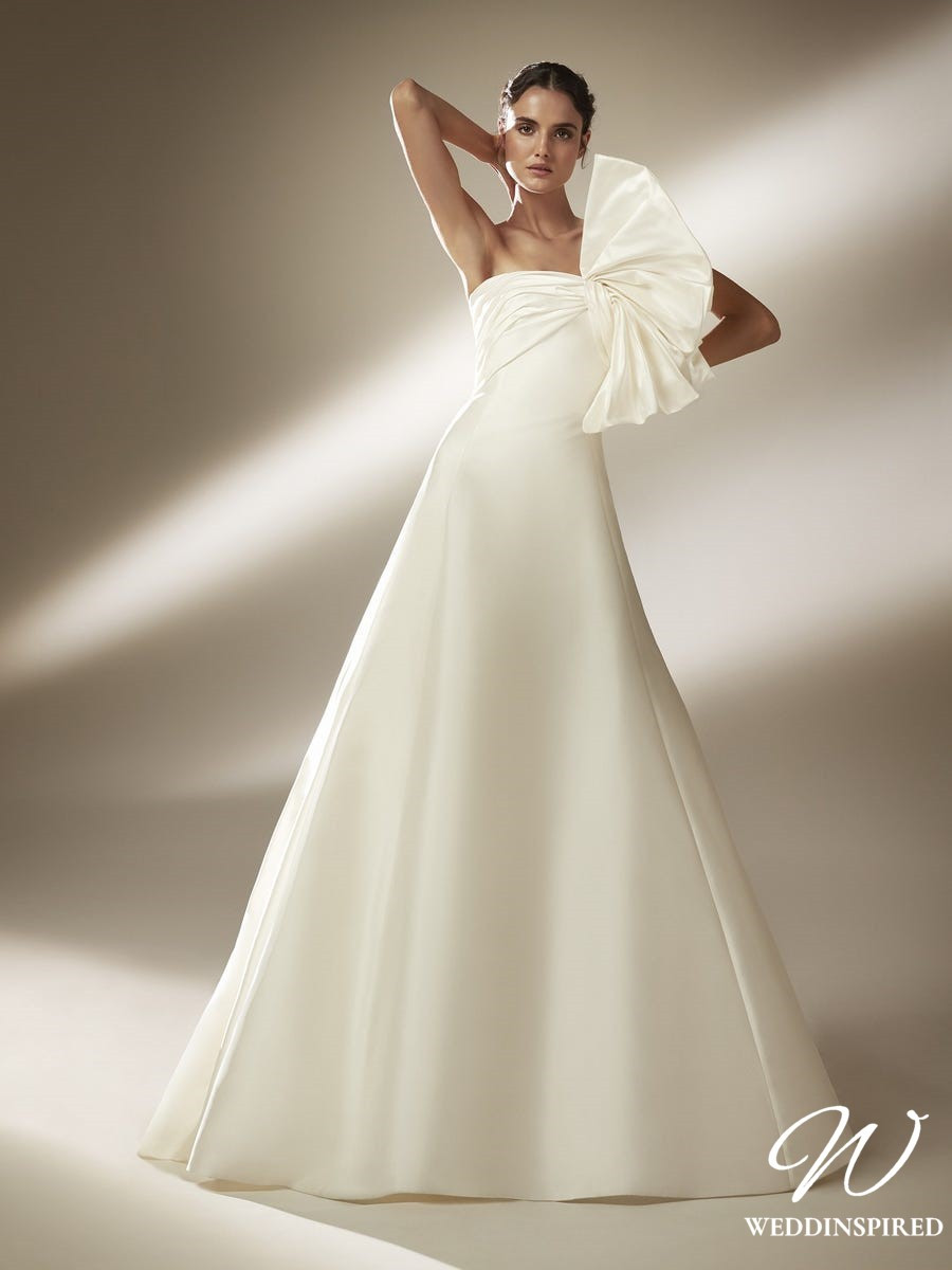 An Atelier Pronovias strapless silk ball gown wedding dress with asymmetrical neckline