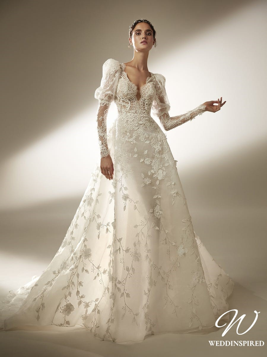 An Atelier Pronovias lace and tulle ball gown wedding dress with long puff sleeves