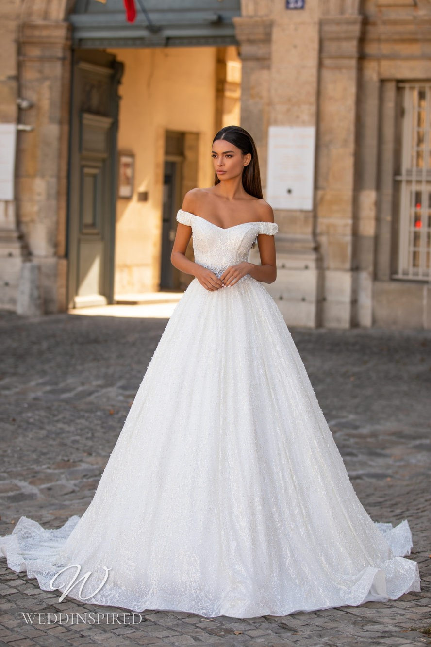 A Milla Nova off the shoulder princess ball gown wedding dress with beading and crystals