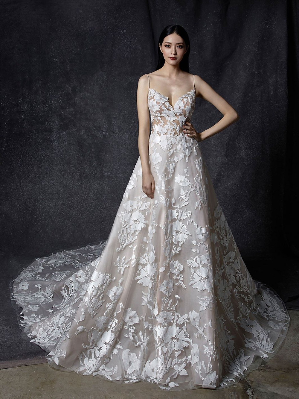 An Enzoani ball gown wedding dress with thin straps and floral print