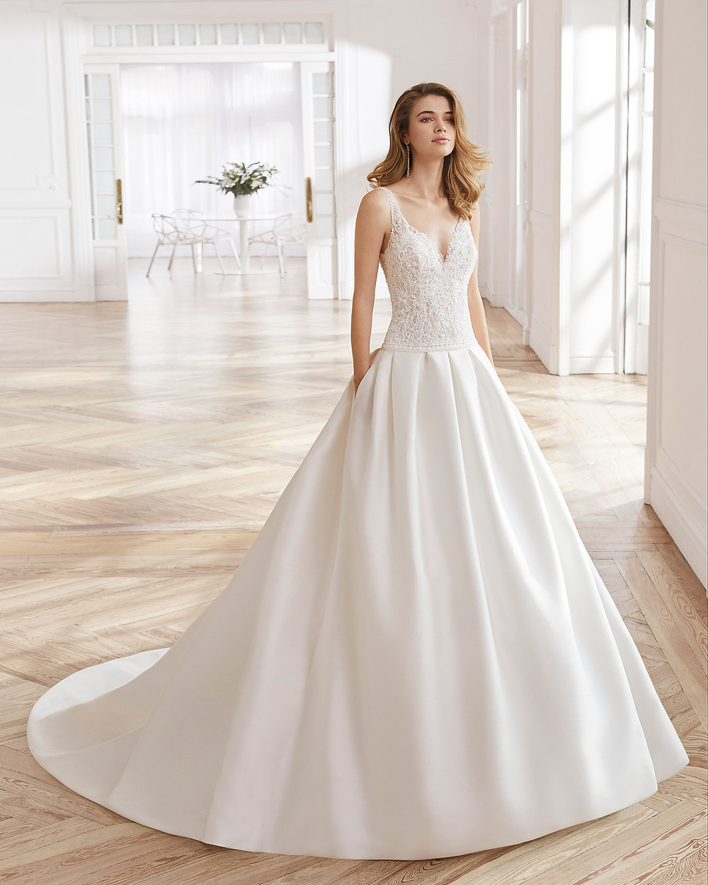 An Aire Barcelona 2020 silk and lace low waist ball gown wedding dress with pockets and a v neckline