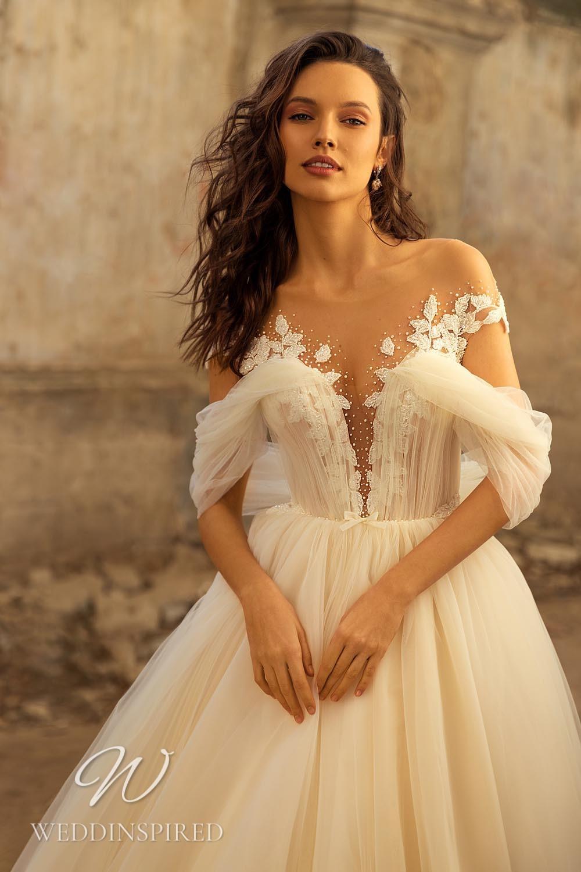 An Eva Lendel 2021 ivory off the shoulder tulle princess wedding dress
