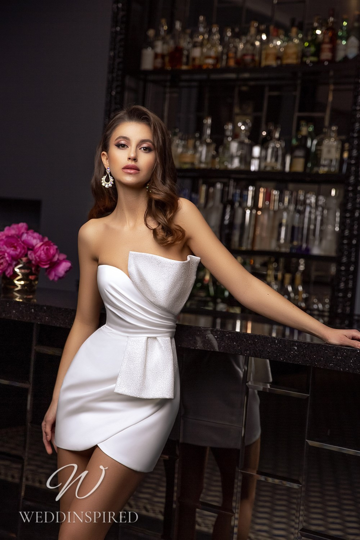 A Tina Valerdi strapless sparkly short wedding dress