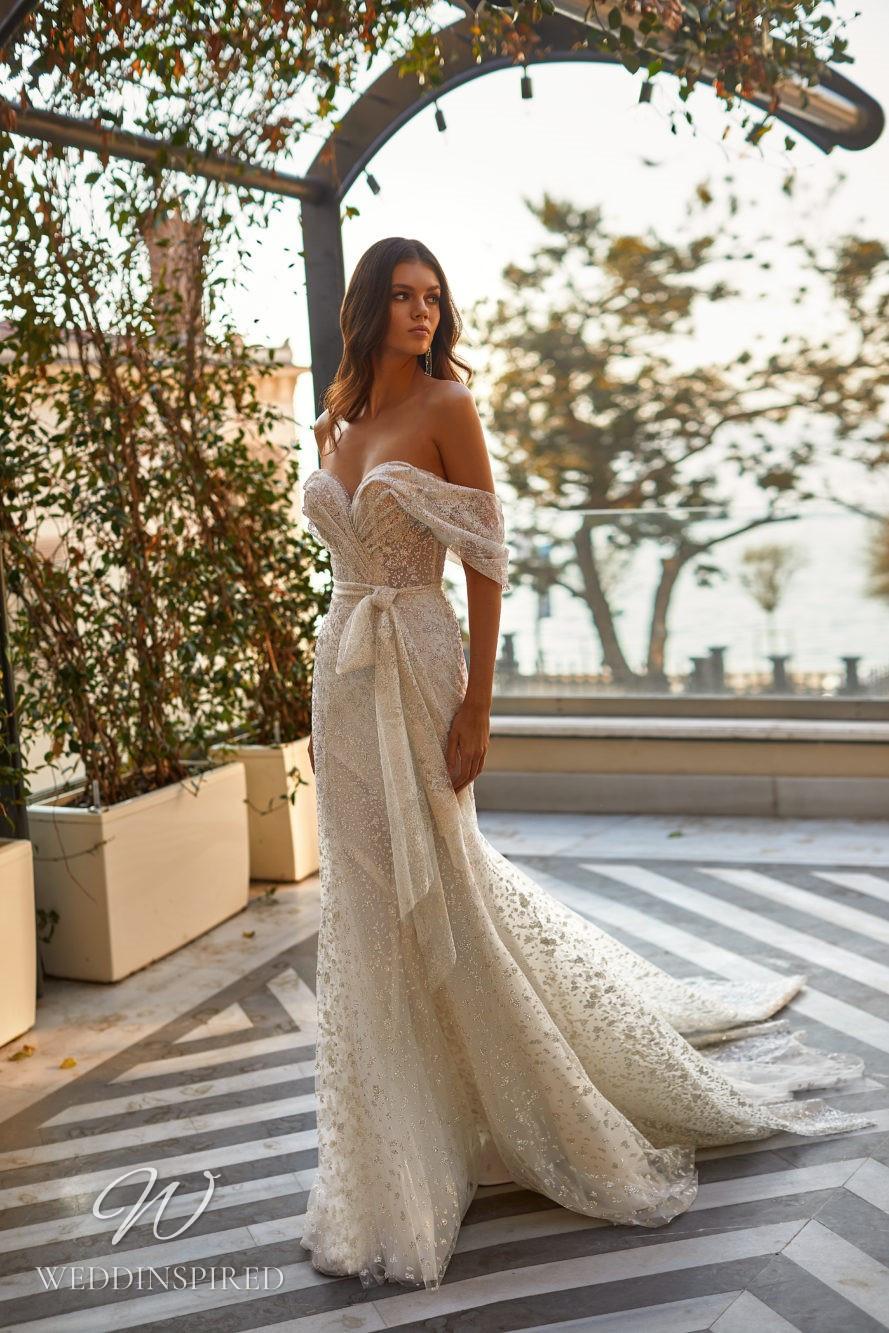 A Milla Nova 2021 ivory off the shoulder sparkly mesh mermaid wedding dress