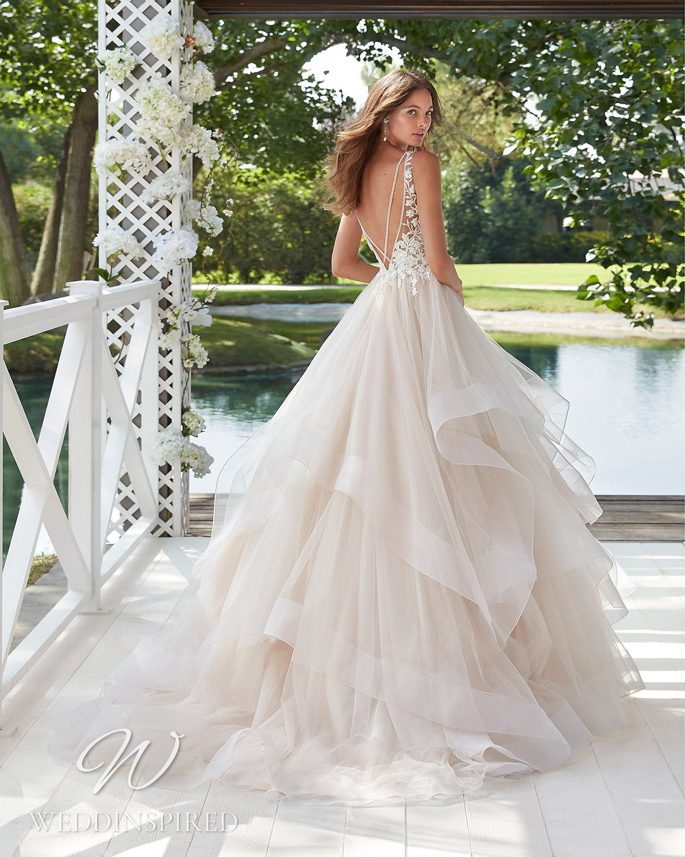 An Aire Barcelona 2021 open back lace and tulle A-line wedding dress