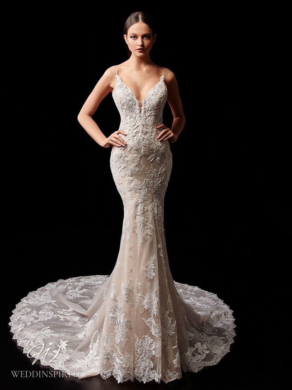 An Enzoani blush lace mermaid wedding dress with straps and a train