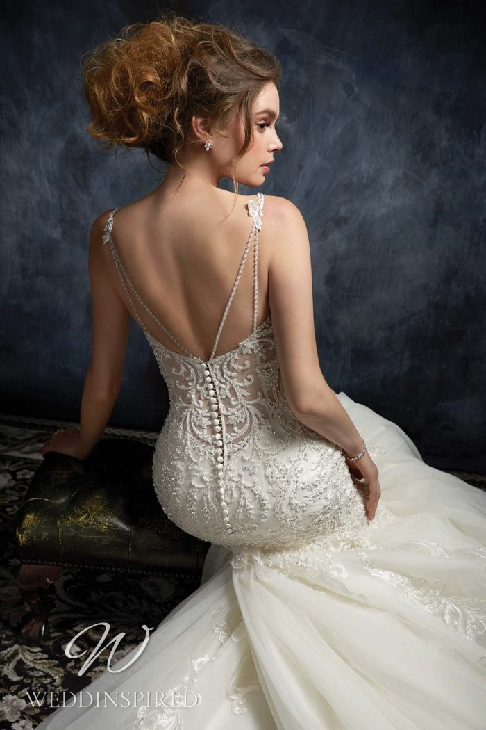 A Kenneth Winston 2021 lace and tulle mermaid wedding dress with a low back