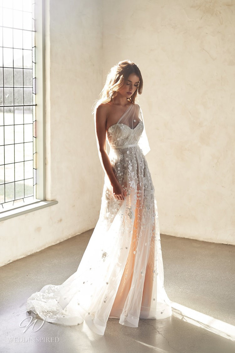 An Anna Campbell 2020 blush one shoulder A-line wedding dress with a tulle skirt and beading