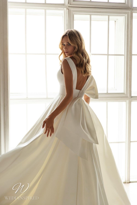 An Eva Lendel 2021 simple silk ball gown wedding dress with a big bow