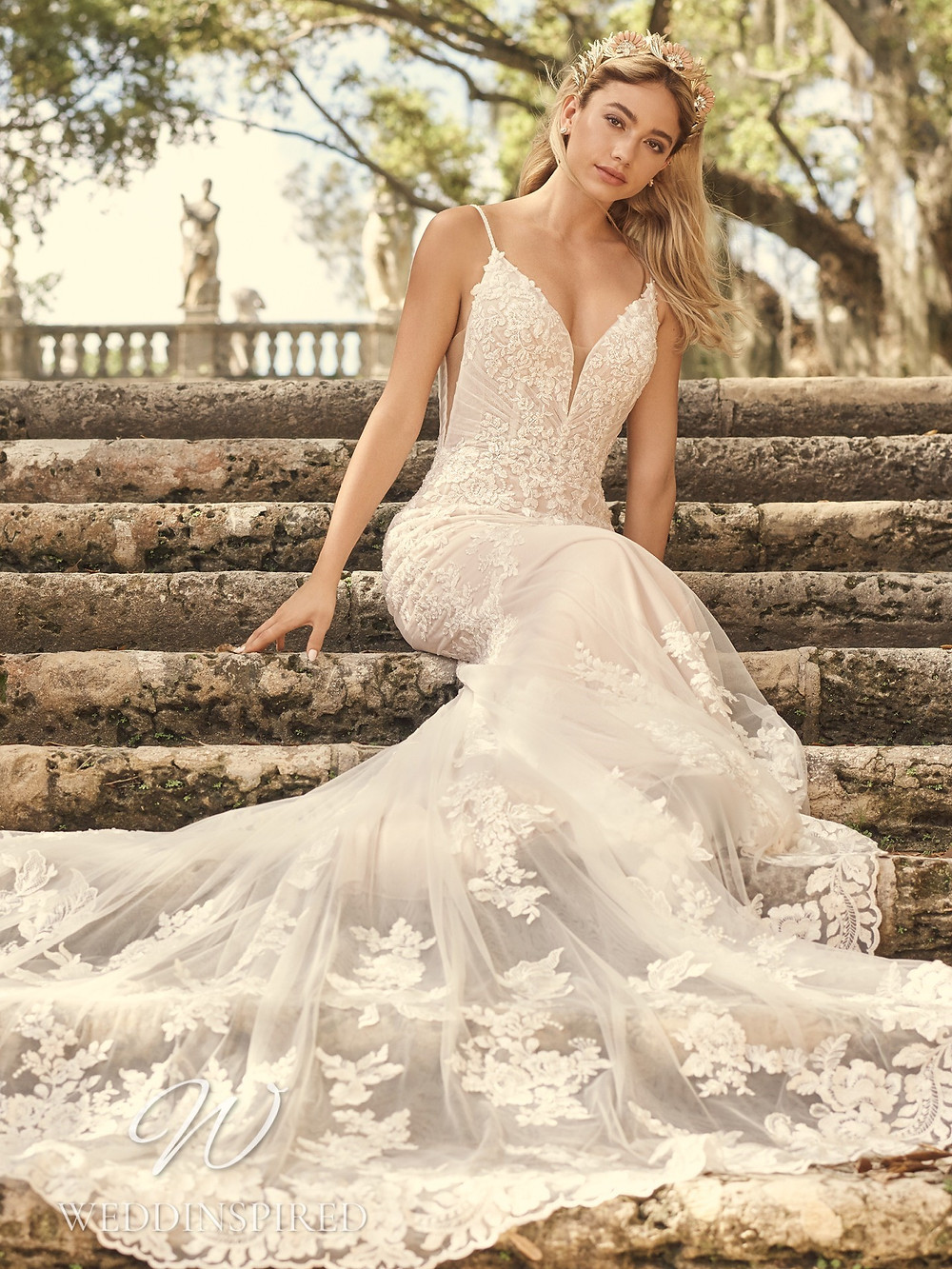 A Maggie Sottero 2021 lace and tulle mermaid wedding dress