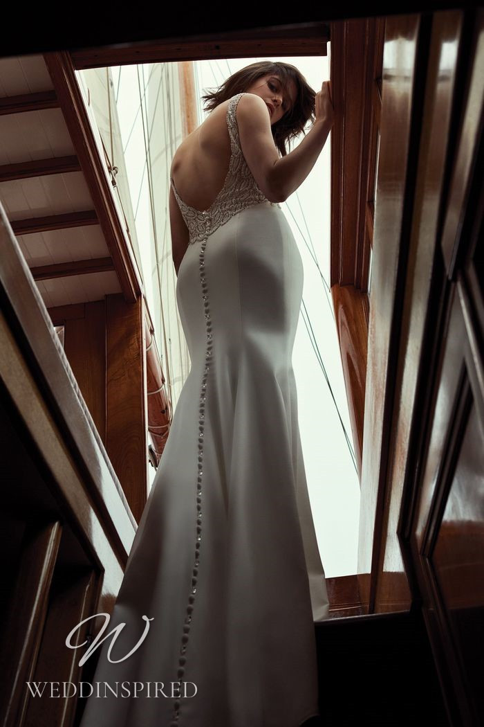 A Justin Alexander 2021 satin and lace mermaid wedding dress