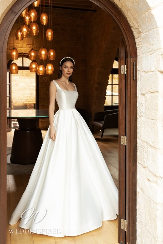 An Ida Torez 2021 simple silk ball gown wedding dress with a square neckline