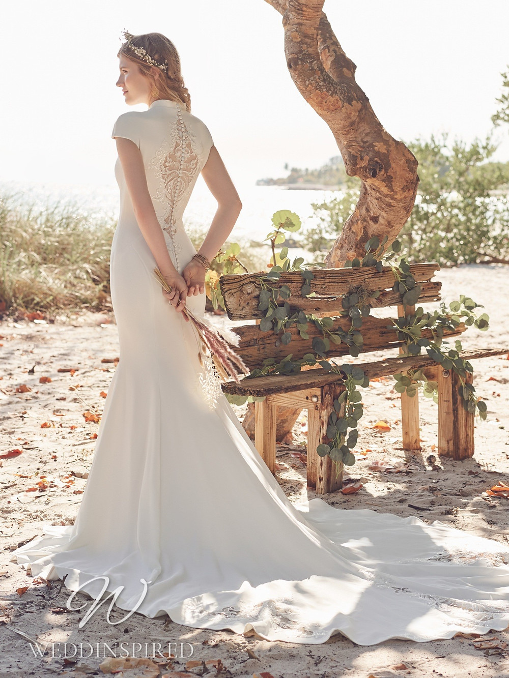 A Rebecca Ingram 2021 simple ivory mermaid wedding dress with a lace back