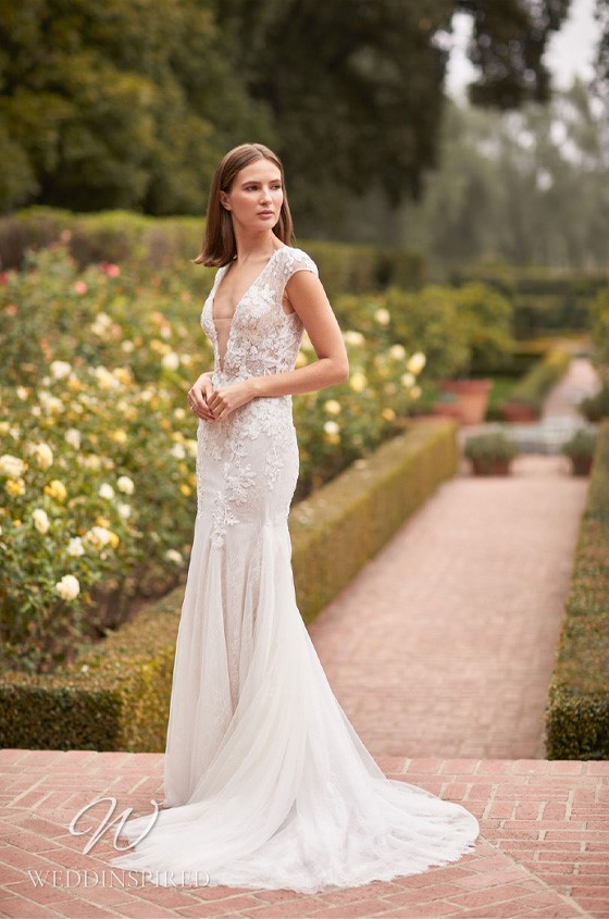 A Monique Lhuillier Bliss Fall 2021 lace and tulle mermaid wedding dress with cap sleeves and a v neck