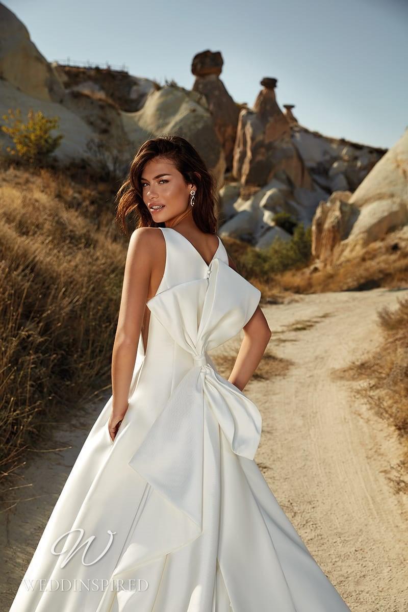 An Eddy K 2021 satin A-line wedding dress with a bow