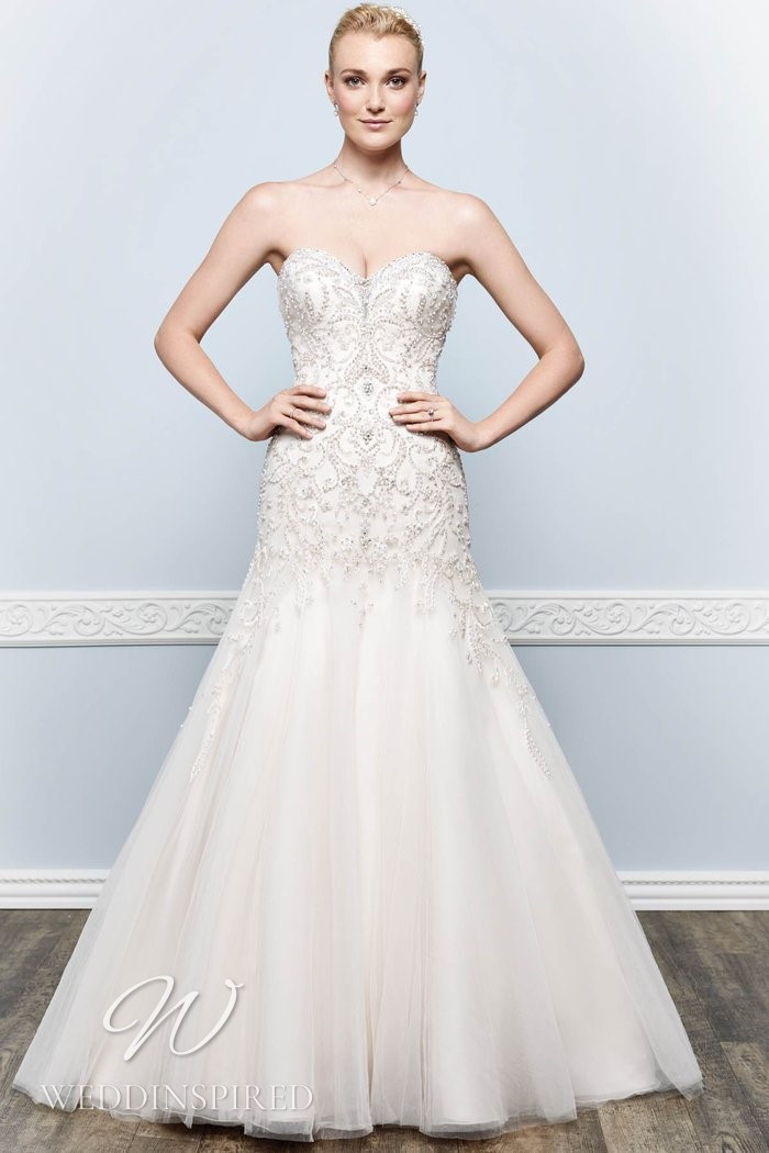 A Kenneth Winston 2021 strapless lace and tulle mermaid wedding dress