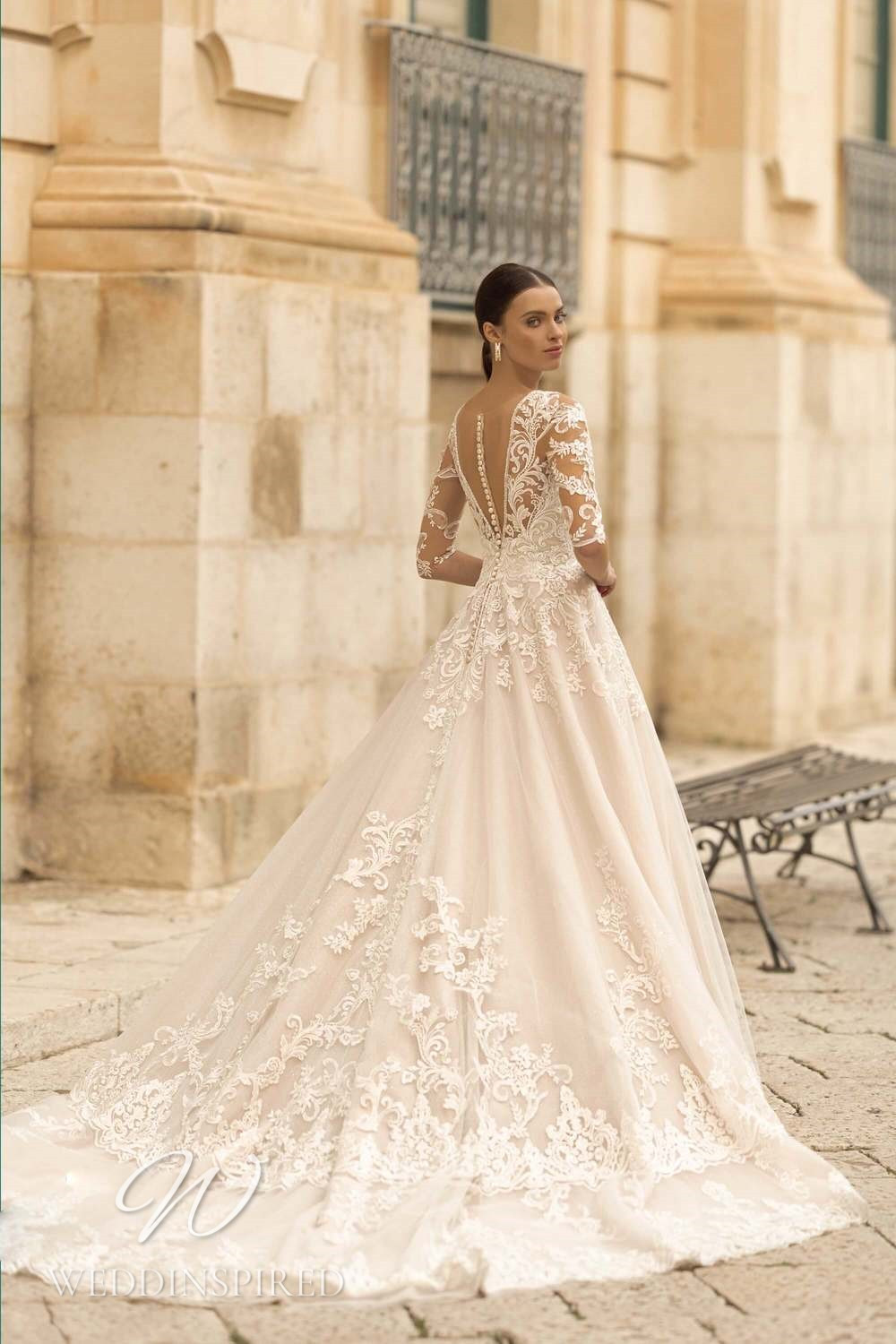 A Lussano 2021 lace and tulle A-line wedding dress with long sleeves